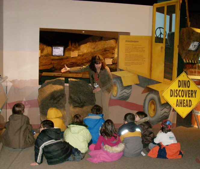 A group of students learn about the trackway
