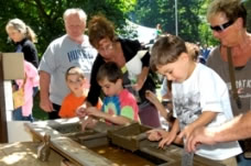 children and adults mining for fossils and minerals